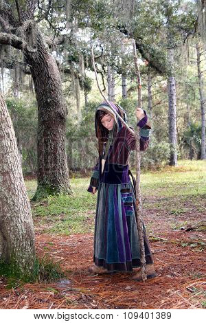Girl With Patchwork Robe In A Forest