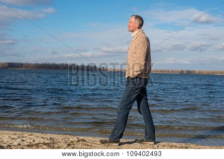 Happy Man, Wearing Casually, Walking Along The Beach