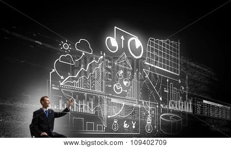 Businessman writing with marker strategy sketches on screen