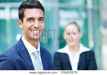 Outdoor portrait of smiling business people