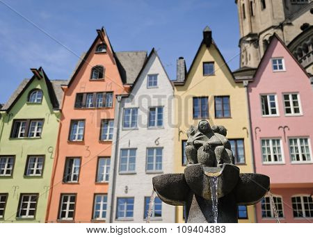 Fountain Near The Colorful Houses In The Old Center Of Cologne, Germany