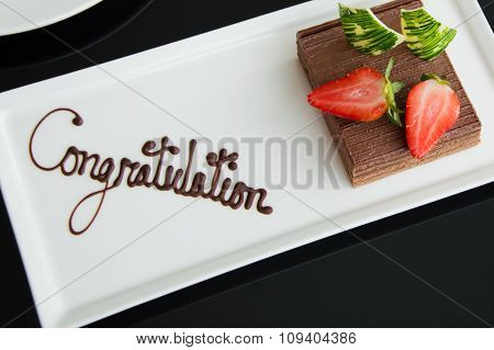 Chocolate Cake With Strawbery On A White Plate