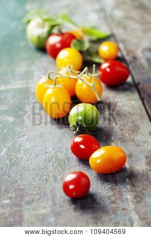 various of colorful tomatoes on wooden background. Cooking, Healthy Eating or Vegetarian concept