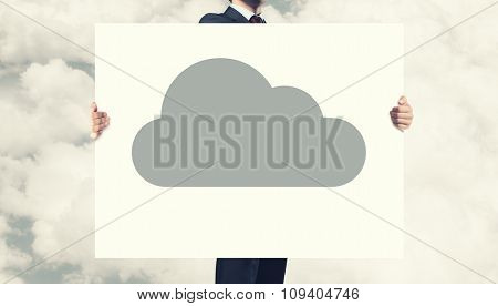 Businessman holding banner with cloud computing concept
