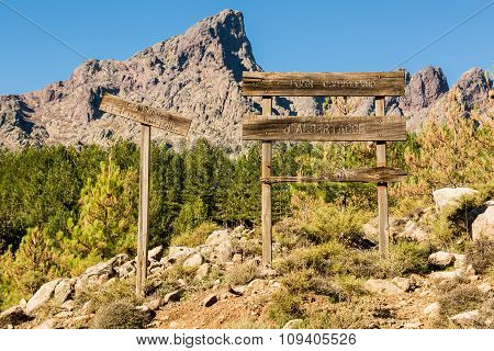 Wooden Signs And Mountains In Forest D'albertacce In Corsica