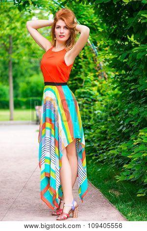 Glamorous Girl Posing In The Summer Park
