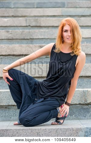 Portrait Of A Girl In Black Clothes On The Steps Of City