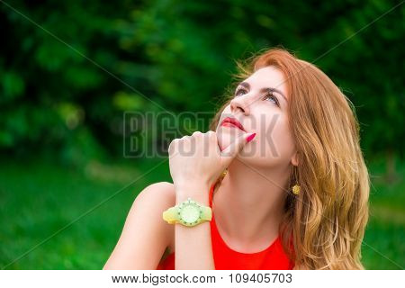 Pensive Portrait Of A Beautiful Woman In A Summer Park