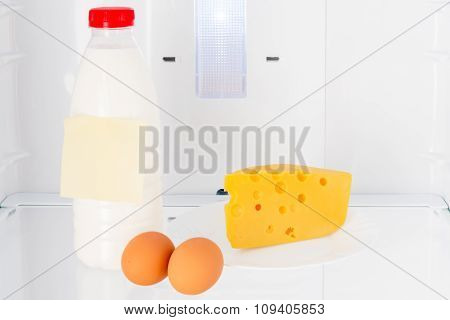 Dairy Products And Eggs On The Shelf Of The Refrigerator