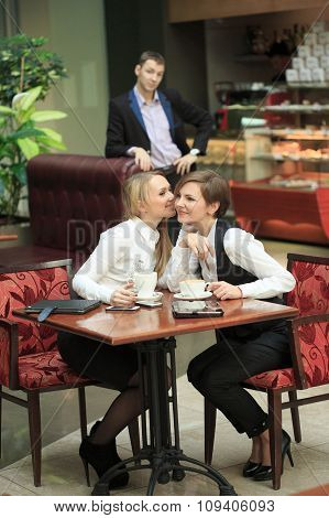 Two girlfriends office staff. in cafe on a business lunch. Happy woman secretive