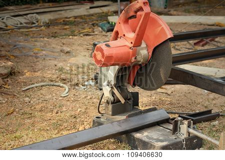 Mechanic Cutting A Steel At The Park