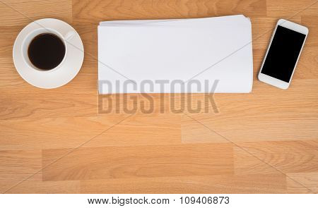 Blank Newspaper with empty space and coffee cup ,mobile phone mock up on wood background