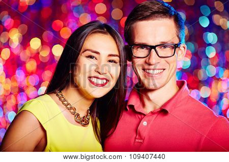 Smiling couple celebrating holiday together