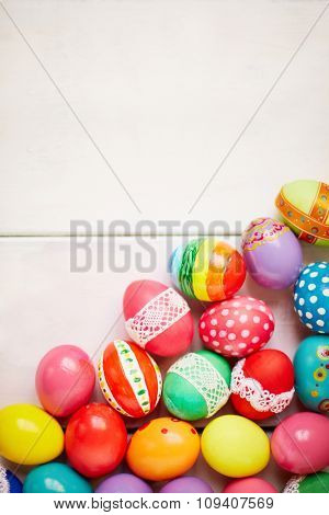 Painted eggs on white background