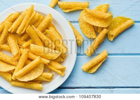 rolled nacho chips on table