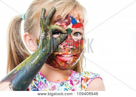 Little Girl With Painted Face Peeping Through Finger Hole.
