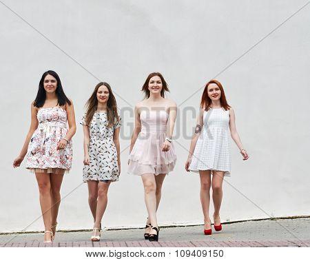 group of young women walking