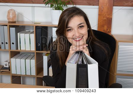 Young And Gorgeous Woman With Long Hair In The Office Working