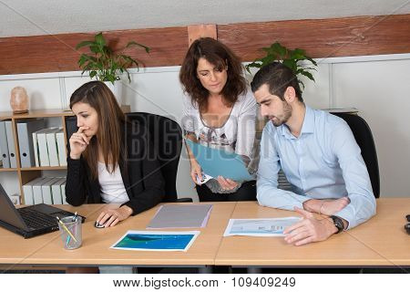 Business Team Of Three Working Together On A Project