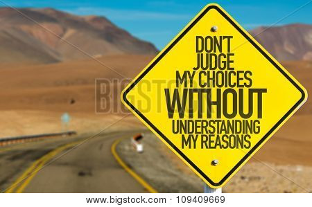 Don't Judge My Choices Without Understanding My Reasons sign on desert road