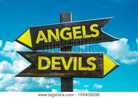 Angels - Devils signpost with sky background