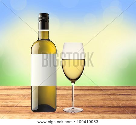 Bottle Of White Wine And Glass On Wooden Table Over Nature Background