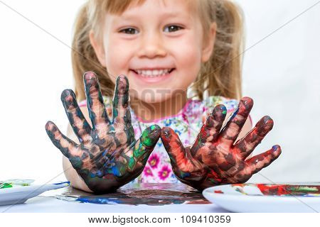 Youngster With Painted Hands At Table.