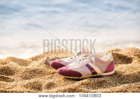 running shoes stand on the beach