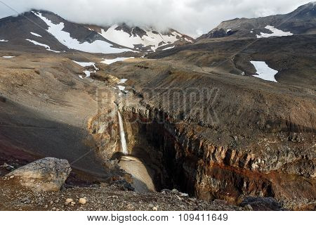 Dangerous Canyon, waterfall under active Mutnovsky Volcano. Kamchatka