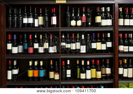 View of row bottles of wine in supermarket