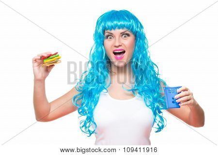 young girl doll with blue hair. plastic eating a sandwich. hunger