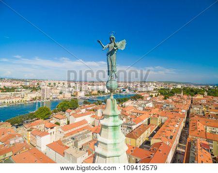 Aerial view of angel on top of cathedral of St Anastasia in Zadar, Croatia.