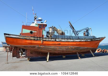 old fishing trawler anchored