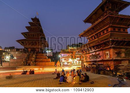 BHAKTAPUR, NEPAL - NOVEMBER 15, 2015: Taumadhi square at night with Nyatapola temple on the left and  Bhairavnath temple on the right.