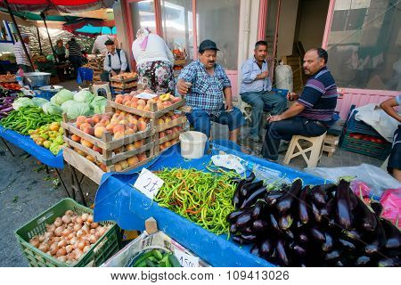 Farmers Sell Vegetables, Eggplant, Peaches And Greens On Rural Turkish Market