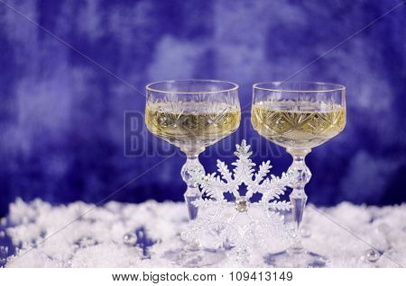 Christmas Glasses Of Champagne On A Blue Background.