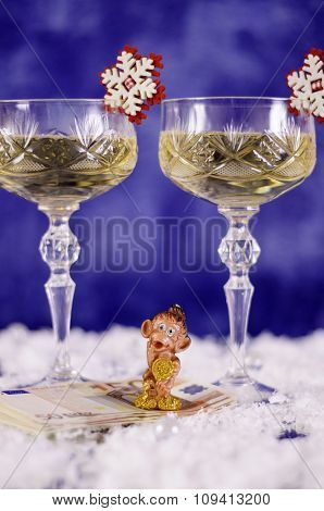 Christmas Glasses Of Champagne And A Monkey On The Euro.