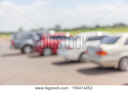 Blurred Photo Of Outdoor Carpark And Countryside View Background.
