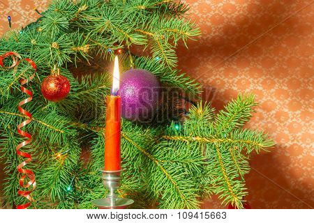 Branch Of A Christmas Trees And Candle