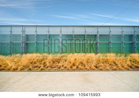 Modern facade with grass and sky