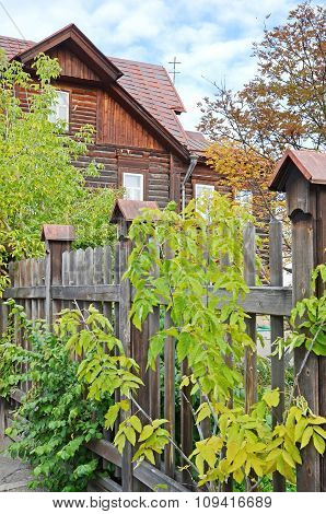 The Wooden House Behind Fence On Irkutsk Street
