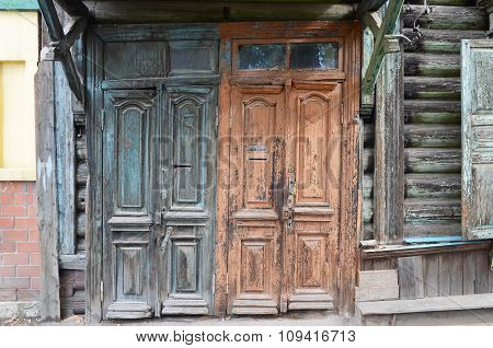 Irkutsk, Russia - Oct.4,2015:The Wooden Dilapidated Doors. Old Entrances In Irkutsk