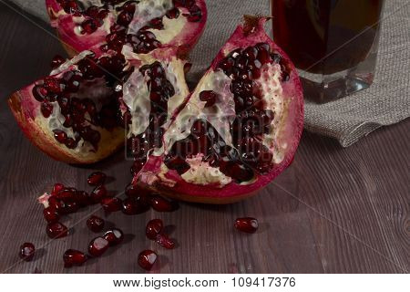 Pomegranate Broken And Glass Of Juice