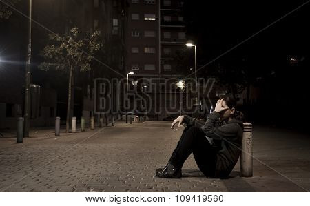 Young Sad Woman Sitting On Street Ground At Night Alone Desperate Suffering Depression Left Abandone