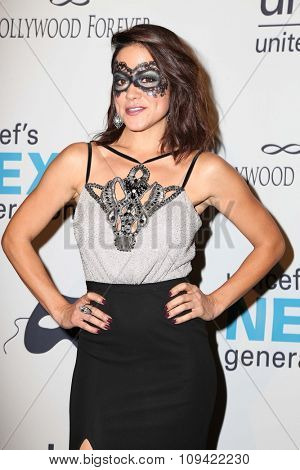 LOS ANGELES - OCT 30:  Camille Guaty at the 2nd Annual UNICEF Masquerade Ball at the Hollywood Forever on October 30, 2014 in Los Angeles, CA