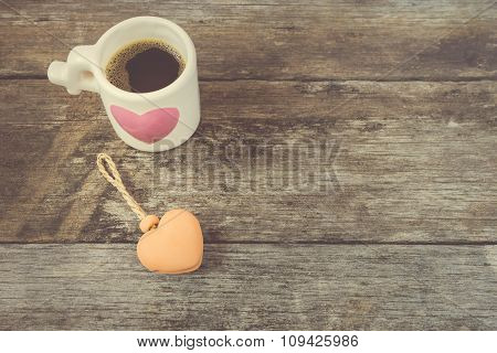 Heart-shaped Pottery Bells On Wooden Background.