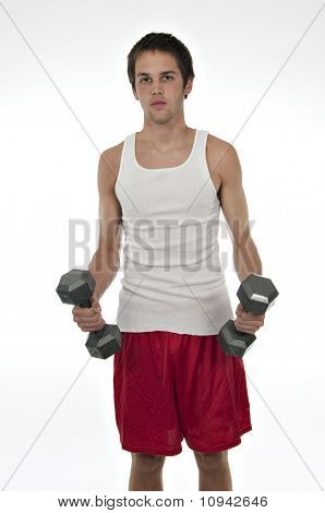 Teenager Holding Weights