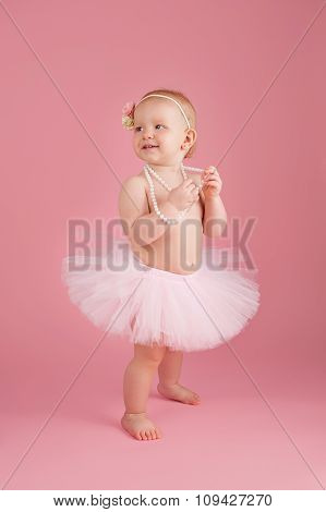 Smiling One Year Old Girl Wearing A Pink Tutu
