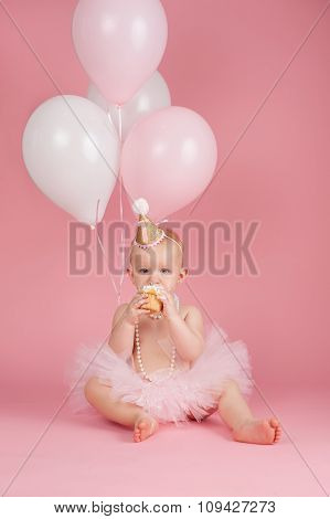 One Year Old Birthday Girl Eating A Cupcake