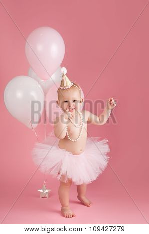 Smiling One Year Old Birthday Girl Wearing A Pink Tutu